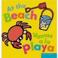 At the Beach / Vamos a la playa (Bilingual Board Book, English/Spanish)